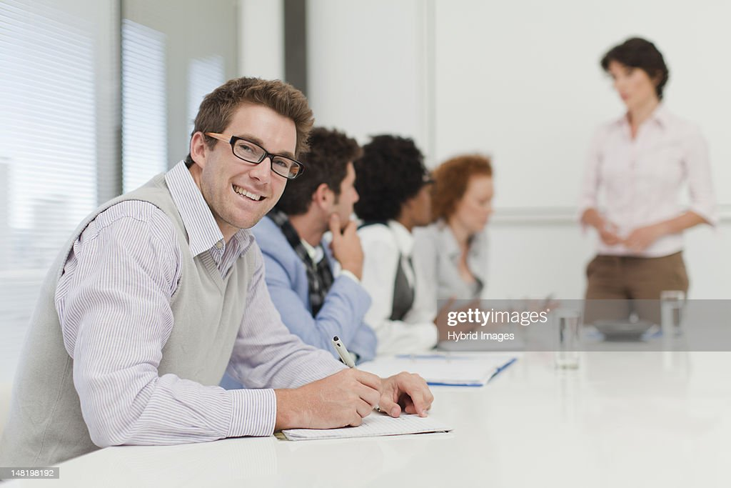 Businessman making notes in meeting : Stock Photo