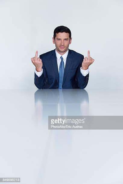 businessman making obscene gesture with both hands, portrait - middle finger funny stock photos and pictures