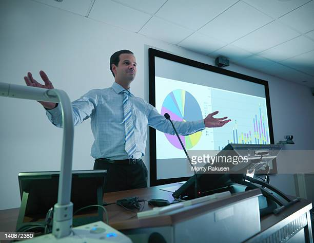 businessman making presentation on screen in conference room - insight tv ストックフォトと画像
