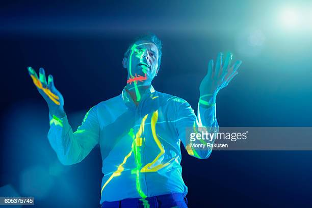 businessman making presentation with projected graphical financial data - tadcaster stock photos and pictures