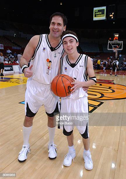 Businessman Mark Cuban and actor Frankie Muniz pose at the Frankie Muniz HoopLA celebrity charity basketball game presented by Pokemon Trading Card...