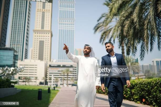 businessman meet and greet - gulf countries stock pictures, royalty-free photos & images