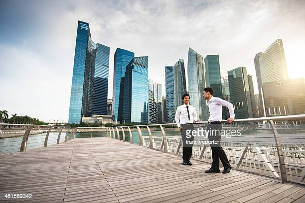 businessman meeting on the city of singapore - south east asia stock pictures, royalty-free photos & images
