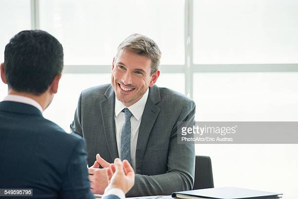 Businessman meeting with associate in office