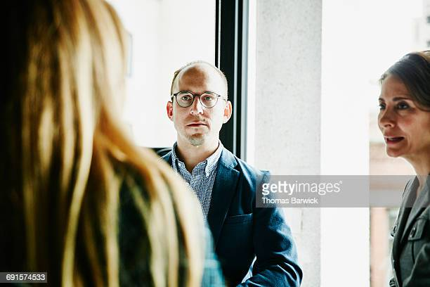 Businessman meeting with colleagues in office