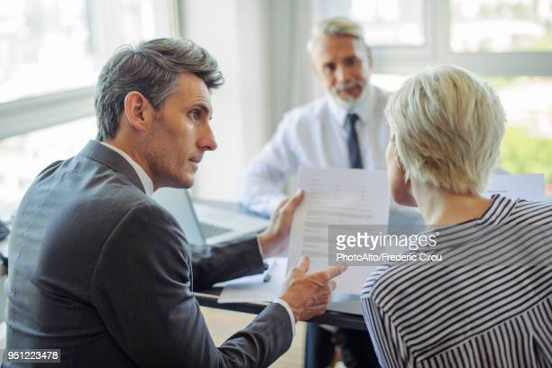 businessman meeting with couple - insurance agent stock pictures, royalty-free photos & images