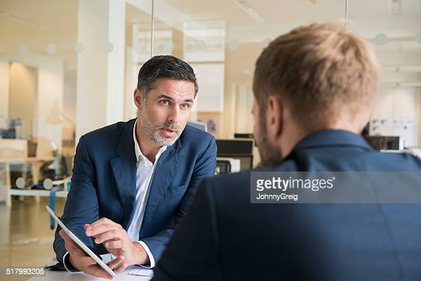 Businessman meeting with digital tablet
