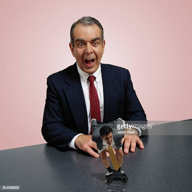 businessman mooning businessman - mooning stock photos and pictures