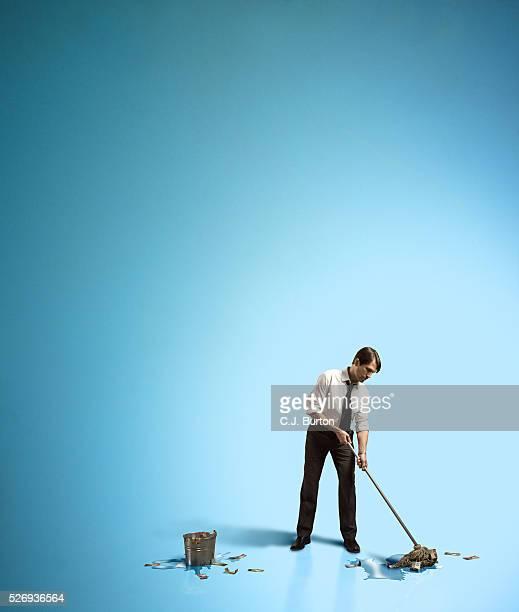 Businessman mopping up dollar bills