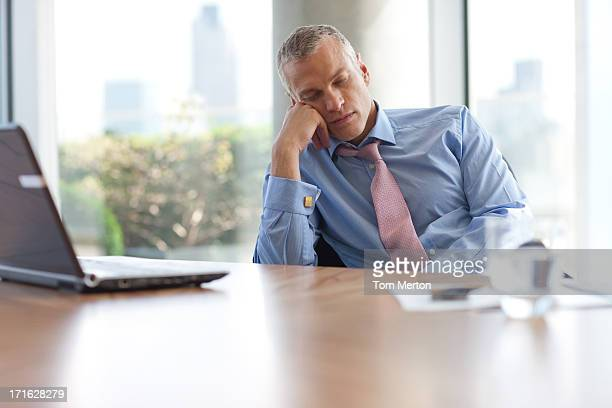 businessman napping at desk in office - wasting time stock pictures, royalty-free photos & images