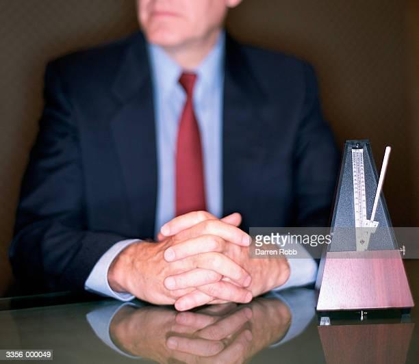 Businessman near Metronome