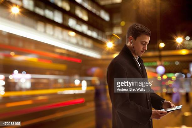 Businessman networking on the move in the city