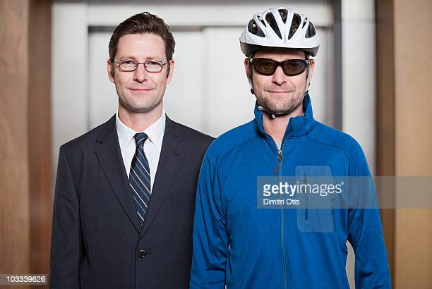 Businessman next to himself dressed as a cyclist