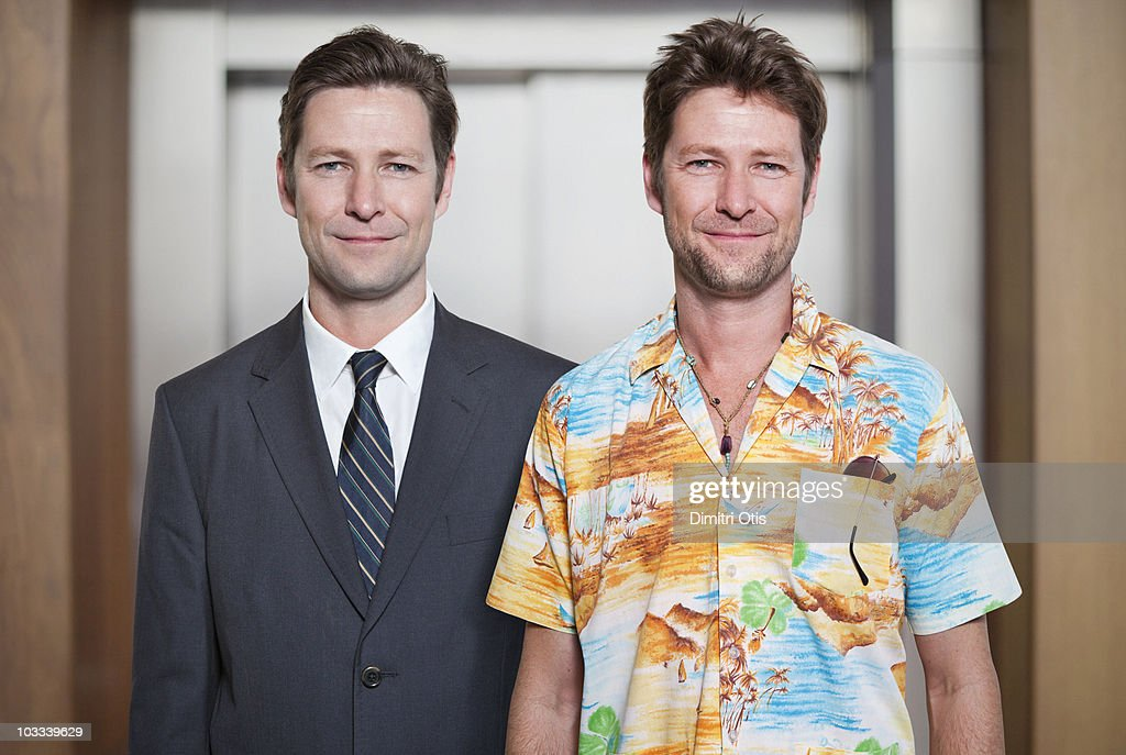 Businessman next to himself dressed casually : Stock Photo