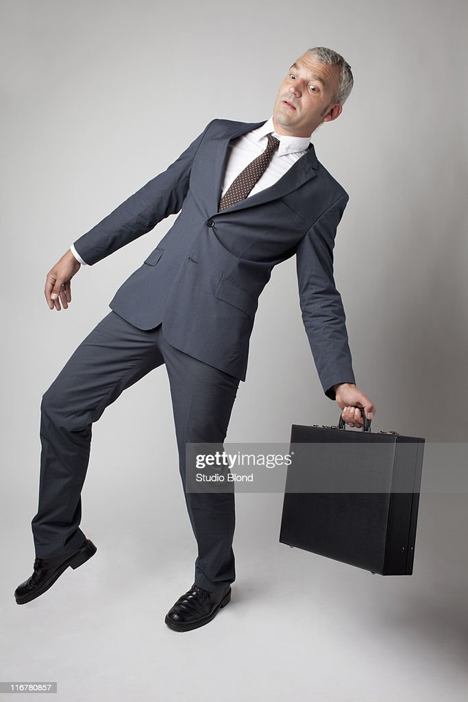 A businessman off balance : Stock Photo