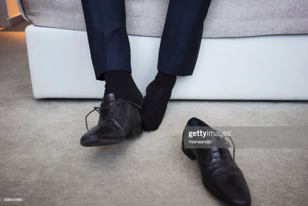 Businessman on a business trip at the hotel room : Stock Photo