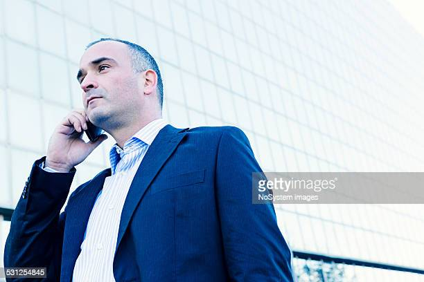 businessman on a cellphone - only mature men stock pictures, royalty-free photos & images