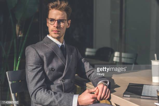 businessman on a coffee break - striped suit stock photos and pictures