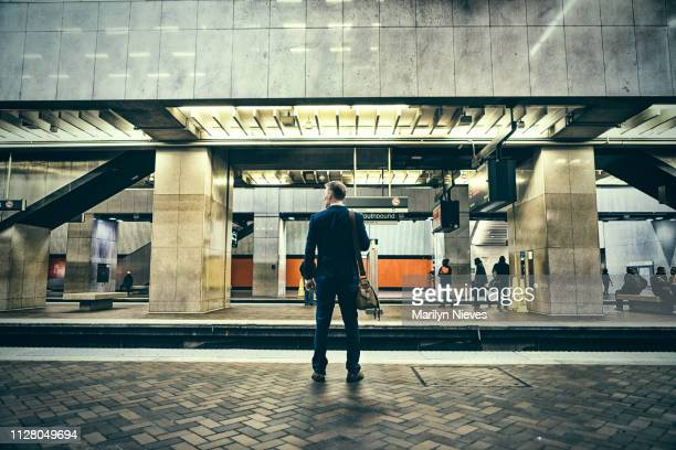 businessman on a journey - railway station stock pictures, royalty-free photos & images