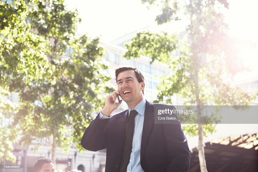 Businessman on a mobile phone outside. : Foto stock