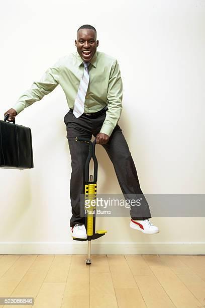 Businessman on a pogo stick
