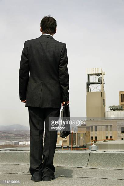Businessman on a roof