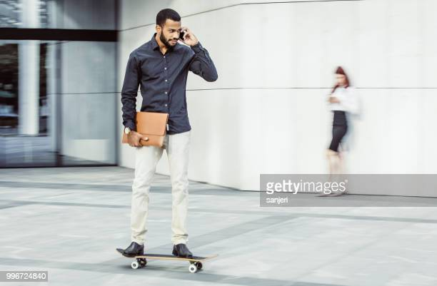Businessman on a Skateboard