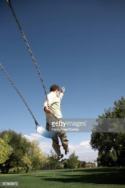 Businessman on a Swing
