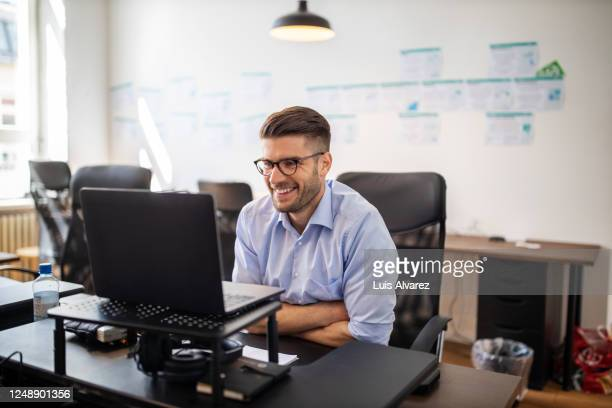 businessman on a video conference meeting - business finance and industry stock pictures, royalty-free photos & images