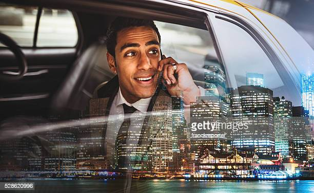 Businessman on a yellow cab in New York City
