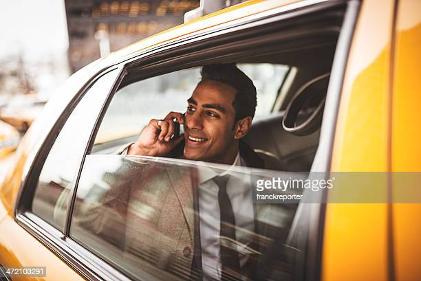 businessman on a yellow cab - yellow taxi stock pictures, royalty-free photos & images