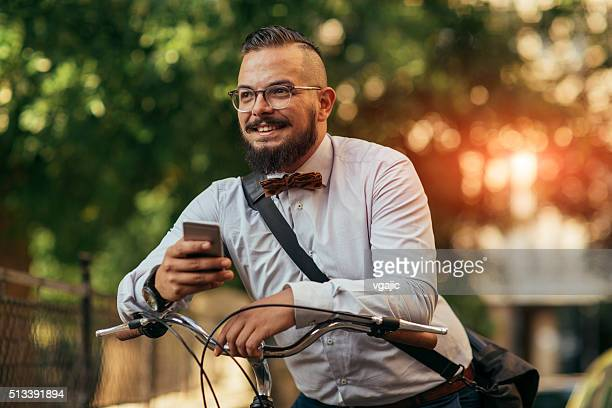 Businessman On Bicycle Using His Phone.