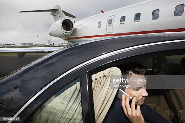 Businessman on cell phone in car