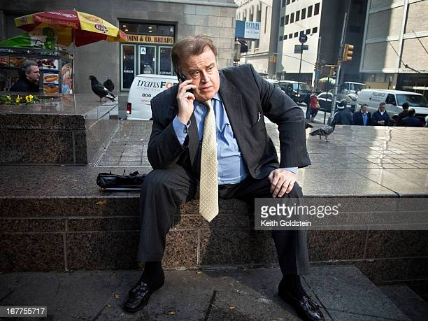 Businessman on cell phone in Zucotti Park.