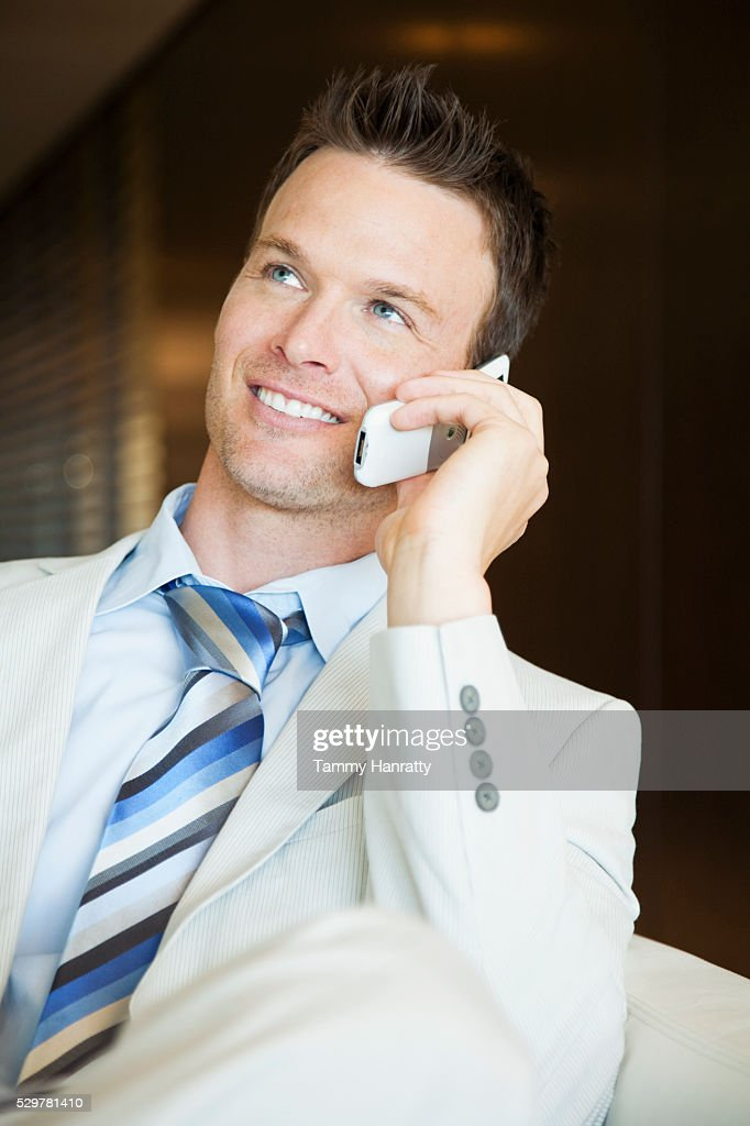 Businessman on cell phone : Bildbanksbilder