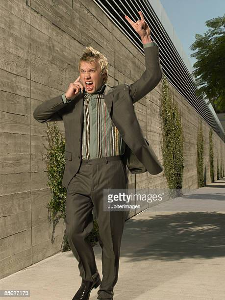 businessman on cellphone - heavy metal stock photos and pictures
