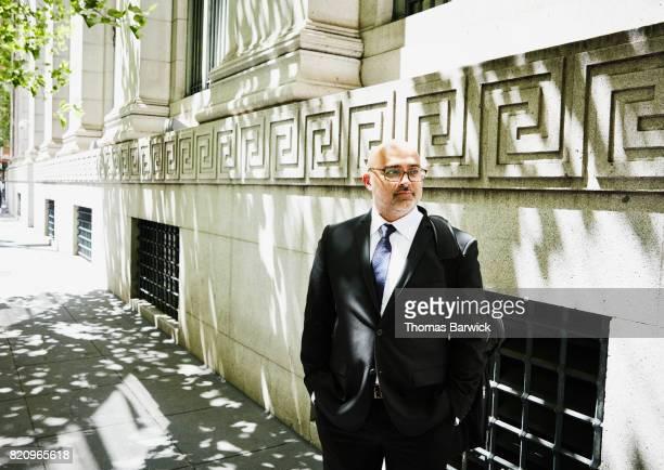 Businessman on city sidewalk