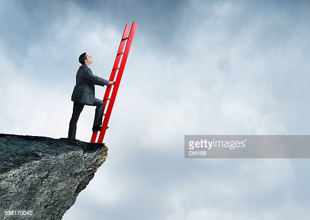 Businessman On Cliff With Nothing To Lean Ladder Against
