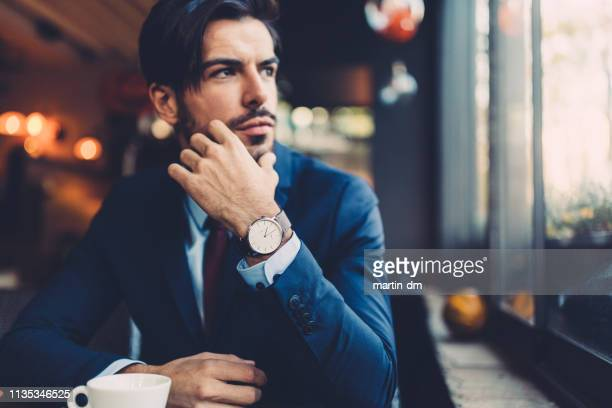 businessman on coffee break - suave stock pictures, royalty-free photos & images
