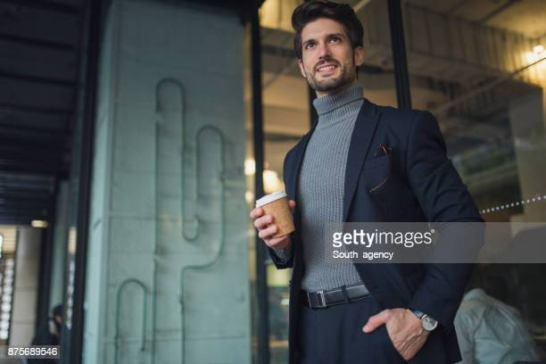 businessman on coffee break - high collar stock pictures, royalty-free photos & images