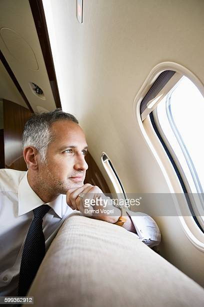 Businessman on corporate airplane