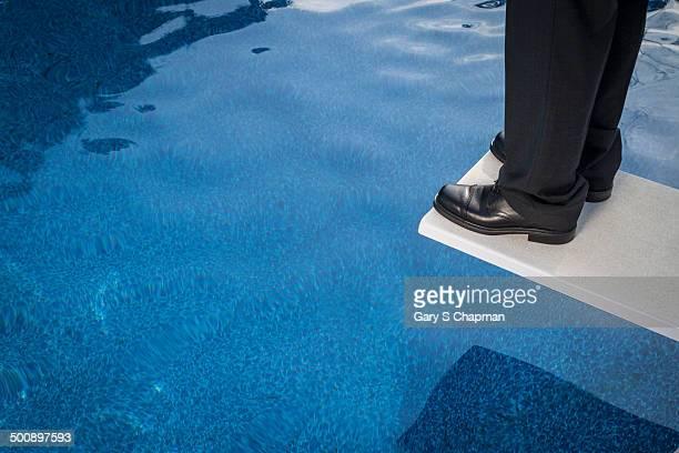 Businessman on diving board