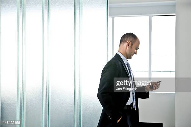 businessman on mobile phone - newtechnology stock pictures, royalty-free photos & images