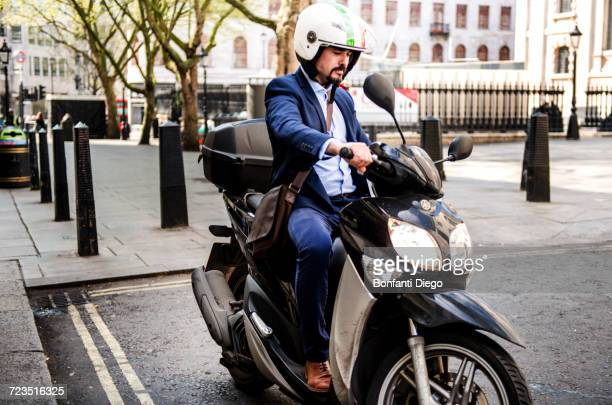 Businessman on motorbike, London, UK
