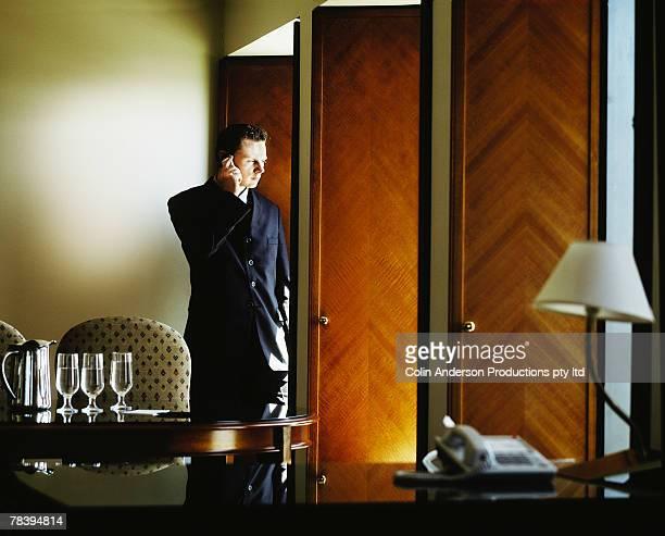 businessman on phone in office - presidente foto e immagini stock