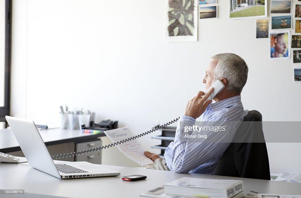 Businessman on phone : Stock Photo