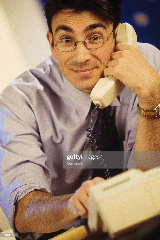 Businessman on phone : Stockfoto