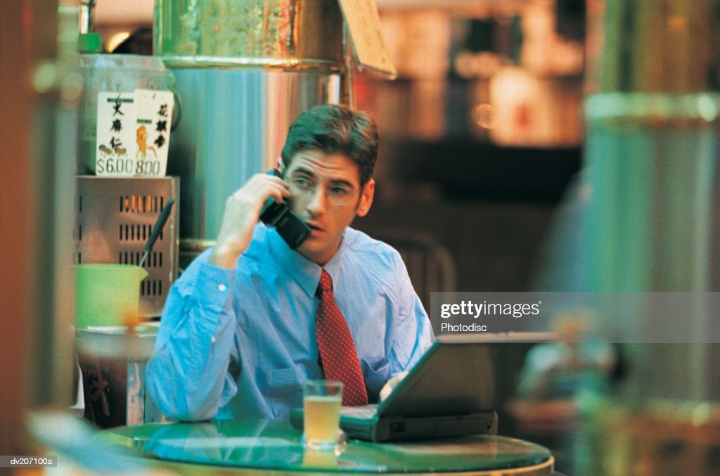 Businessman on phone with laptop : Stock Photo