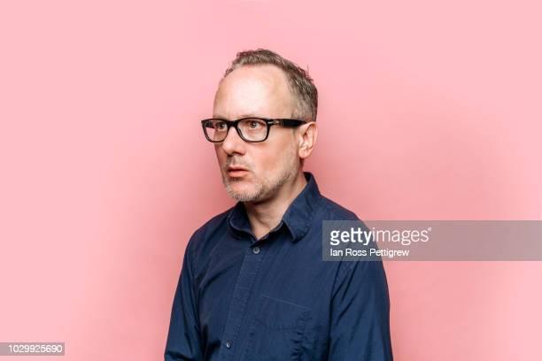 businessman on pink background - überraschung stock-fotos und bilder