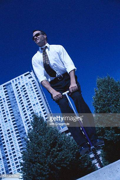 Businessman on Pogo Stick